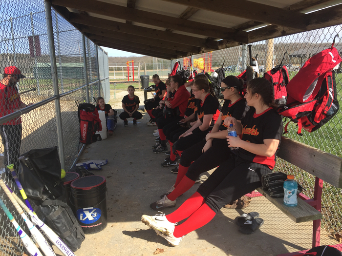 Softball team in the dugout