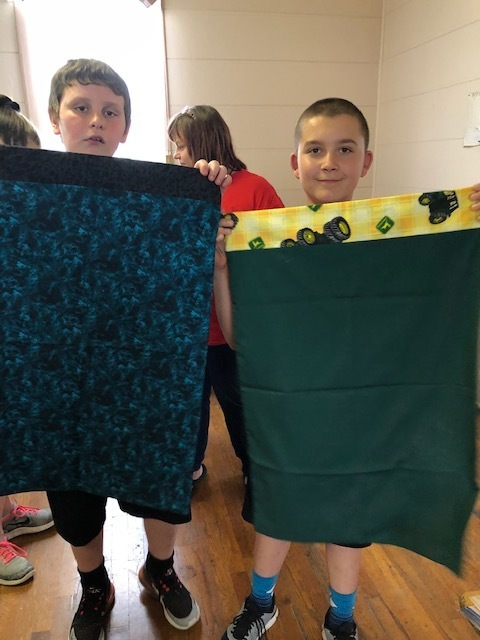 Students were schooled in what it was like to attend a one room school house.  Each student received a pillowcase and snacks made by the Linnville ladies.  Thank you Linnville ladies for a great day!